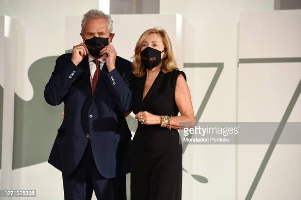 Italian politician Francesco Rutelli and his wife journalist Barbara Palombelli at the 77 Venice International Film Festival 2020 Revange room red...
