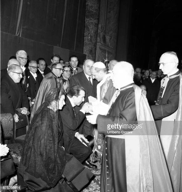 Italian politician Giulio Andreotti and his wife Livia Danese with Pope Paul VI during the Mass celebration in St Peter's Basilica 1964