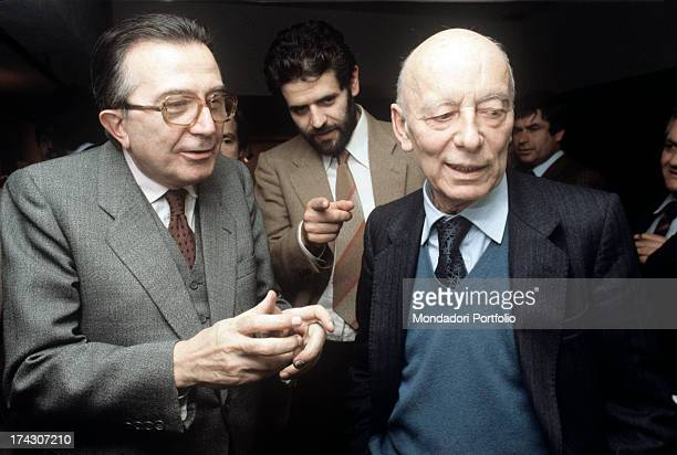 Italian politician Giulio Andreotti talking with Italian politician Giancarlo Pajetta Behind them Italian politician Roberto Formigoni 1980s