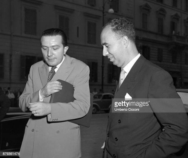 Italian politician Giulio Andreotti talks to Paolo Emilio Taviani in front of Chamber of Deputies Rome 1949