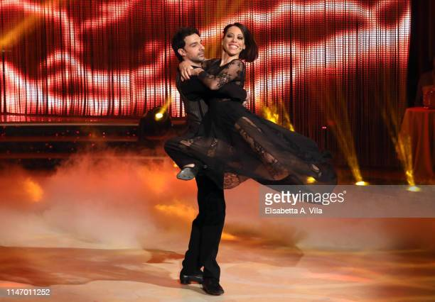 Italian politician Nunzia De Girolamo and her dance partner Raimondo Todaro perform on the Italian TV show 'Ballando Con Le Stelle' at RAI Auditorium...