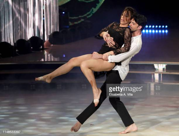 Italian politician Nunzia De Girolamo and her dance partner Raimondo Todaro perform on the Italian TV show Ballando Con Le Stelle at RAI Auditorium...