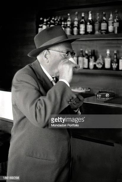 Italian politician Pietro Nenni drinking a coffee at the bar in a café He's taking part in the congress of the Italian Socialist Party at the Teatro...