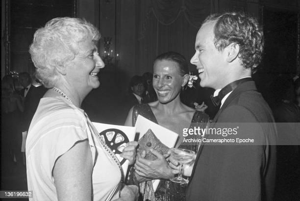 Italian politician Susanna Agnelli with Aberto II of Monaco and Ornella Vanoni at the Tribute To Ingrid Gala Venice 1983