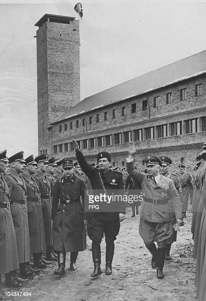 Italian politician Tullio Cianetti of the Fascist Confederation of Industrial Workers' Syndicates, with Nazi politician Robert Ley , head of the...