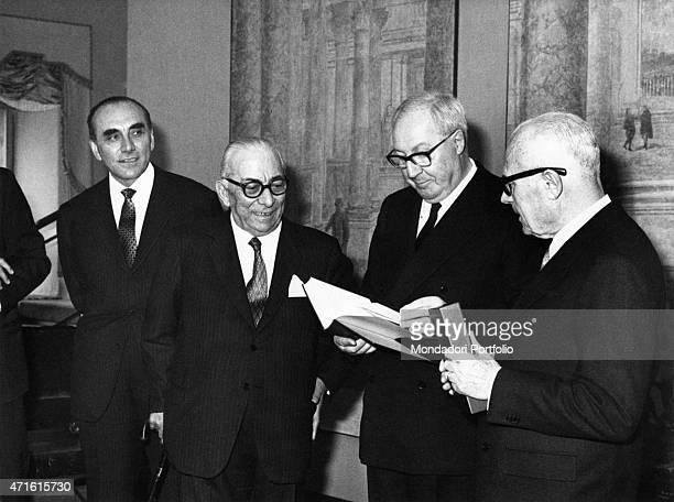 Italian politicians Sandro Pertini and Giuseppe Saragat leafing thorugh a book made by Italian publisher Arnoldo Mondadori Italy 1960s