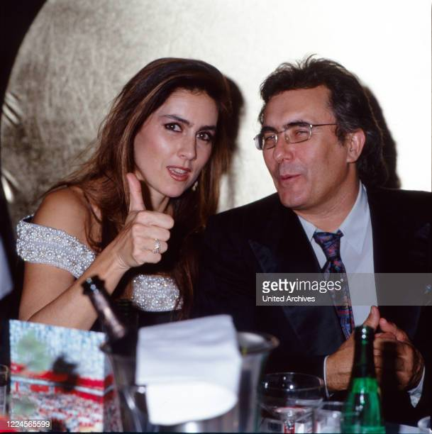 Italian pop duo and couple Romina Power and Al Bano Carrisi at an evening event late 1990s