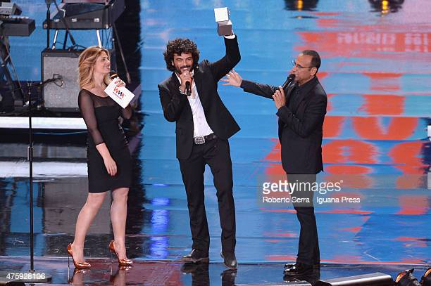 Italian pop singer Francesco Renga attends the 2015 Wind Music Awards with presenters Valeria Incontrada and Carlo Conti at Arena di Verona on June 4...