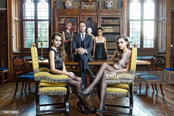 Italian pornographic actor and director Rocco Siffredi posing surrounded by some girls in thestudy of an ancient villa Italy 30th November 2011
