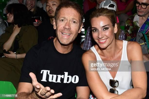 Italian pornographic actor Rocco Siffredi and his wife Hungarian pornographic actress Rosa Caracciolo attend the presentation of Italian fashion...
