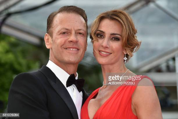 Italian pornographic actor Rocco Siffredi and his wife Rosa Caracciolo pose on May 12 2016 as they arrive for the screening of the film 'Money...