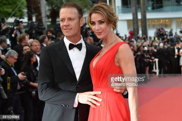 """Italian pornographic actor Rocco Siffredi and his wife Rosa Caracciolo pose on May 12, 2016 as they arrive for the screening of the film """"Money..."""