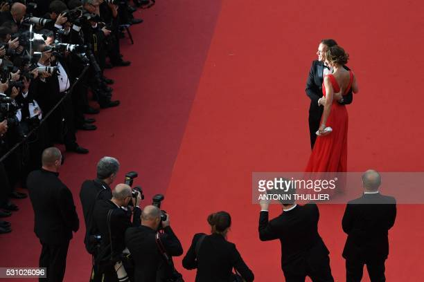 Italian pornographic actor Rocco Siffredi and his wife Rosa Caracciolo pose on May 12 2016 as they arrive for the screening of the film Money Monster...
