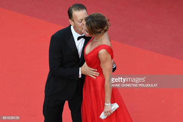 Italian pornographic actor Rocco Siffredi kisses his wife Rosa Caracciolo on May 12 2016 as they arrive for the screening of the film Money Monster...