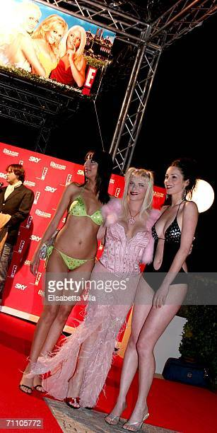 Italian pornostar Ilona Staller poses with models during a party to celebrate Hugh Hefner's 80th birthday and 50 years of Playboy at Villa Miani on...