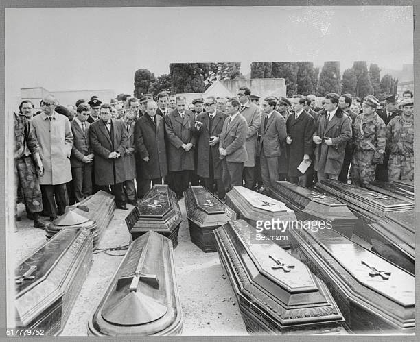 Italian Premier Aldo Moro and other officials pay final respects to victims of last week's earthquake on January 20th Moro began a tour of the...