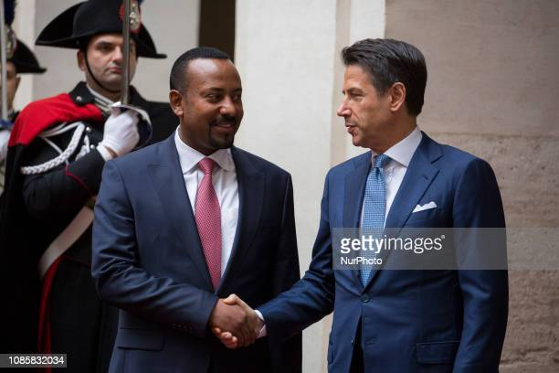 Italian Premier Giuseppe Conte shakes hands with Ethiopian Prime Minister Abiy Ahmed Ali at Chigi Palace in Rome Italy 21 January 2019