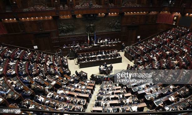 Italian premier Giuseppe Conte speaks at the Lower House ahead of a confidence vote on the government program in Rome on June 6 2018 Conte is set to...