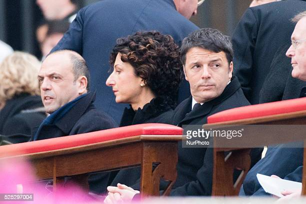 Italian Premier Matteo Renzi, his wife Agnese Landini attend a Mass celebrated by Pope Francis prior to the opening of the Holy Door of St. Peter's...