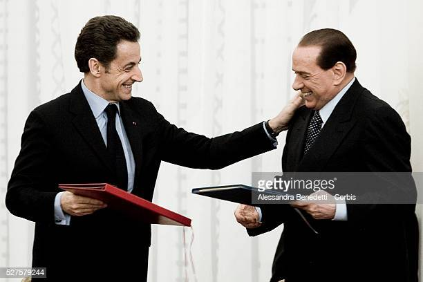 Italian Premier Silvio Berlusconi and French President Nicolas Sarkozy during the signing of an agreement at a ceremony in Rome's Villa Madama...