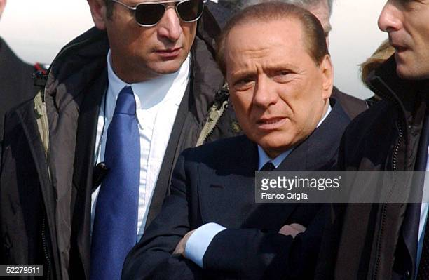Italian Premier Silvio Berlusconi waits at Ciampino Rome airport for the arrival of freed Italian hostage Giuliana Sgrena, a day after she was...
