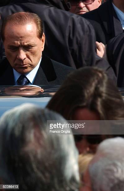 Italian Premier Sivlio Berlusconi leaves Santa Maria Degli Angeli Basilica at the end of the State funeral of Italian intelligence officer Nicola...
