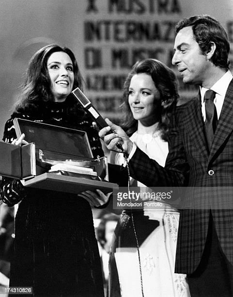 Italian presenters Daniele Piombi and Aba Cercato giving the prize Gondola d'Oro to Italian singer Gigliola Cinquetti Venice 1974