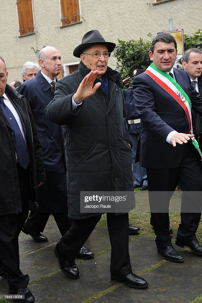 Italian President Giorgio Napoliatano waves to wellwishers as he pays his respects to the victims of the Sant'Anna Di Stazzema Nazi Massacre on March 24, 2013 in Sant'Anna di Stazzema, near Lucca, Italy. The heads of state paid homage to the 560 victims of the Nazi massacre which took place on August 12, 1944. The ceremony was also attended by survivors and relatives of the victims.