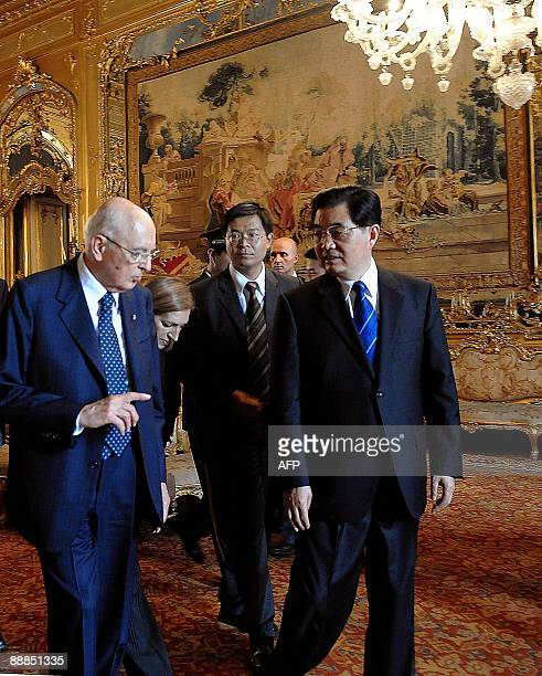 Italian President Giorgio Napolitano and his Chinese counterpart Hu Jintao walk to a press conference during their meeting on July 6, 2009 at The...