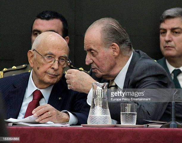 Italian President Giorgio Napolitano and King Juan Carlos of Spain speak as they attend the COTEC Europa Meeting at Palacio El Pardo on October 3...