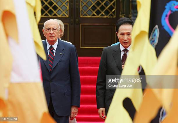Italian President Giorgio Napolitano and South Korean President Lee MyungBak walk towards a guard of honour during a welcoming ceremony held at the...