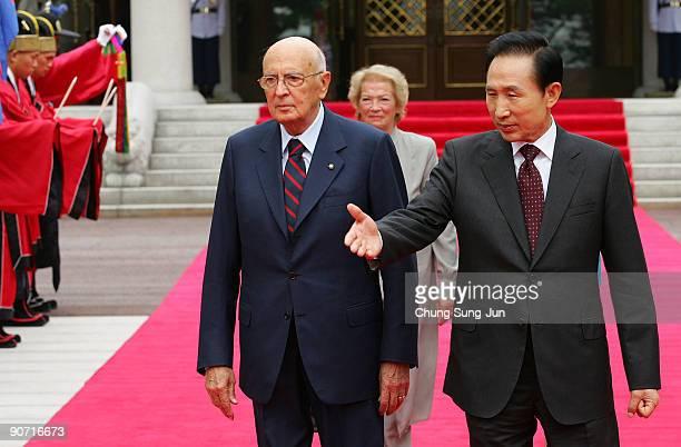 Italian President Giorgio Napolitano his wife Clio Napolitano and South Korean President Lee MyungBak walk towards a guard of honour during a...
