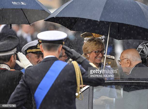 Italian President Giorgio Napolitano is welcomed by Italian defence minister Roberta Pinotti as he arrives at Piazza Venezia to celebrates Italy's...