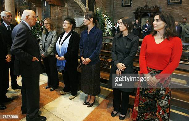 Italian President Giorgio Napolitano pays his homage to, from second left, Italian tenor Luciano Pavarotti's widow Nicoletta Mantovani, his sister...