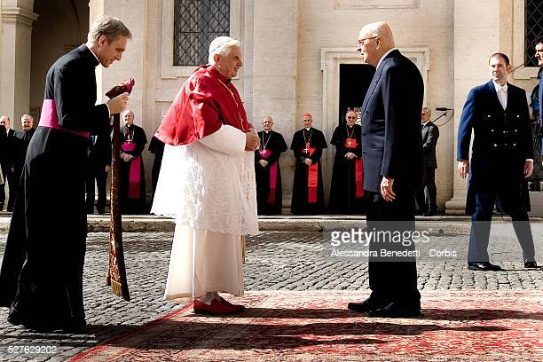 Italian President Giorgio Napolitano welcomes Pope Benedict XVI upon his arrival to the Quirinale Presidential Palace for an officiale State visit
