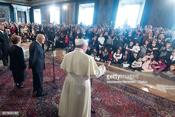 Italian President Giorgio Napolitano welcomes Pope Francis at Quirinale Palace during his first official visit to the italian presidential residency...