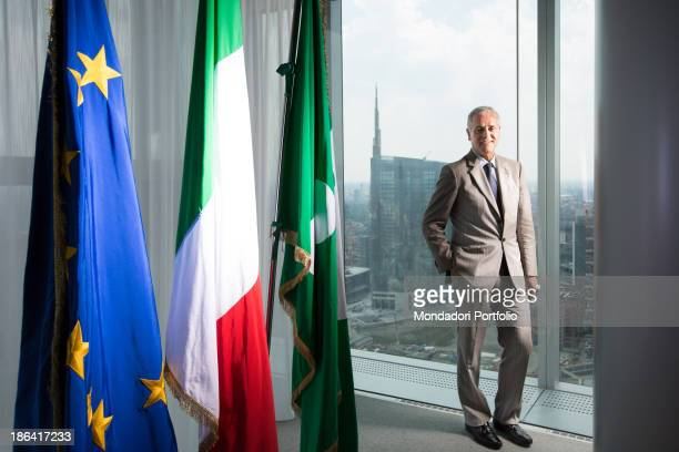 Italian President of Lombardy Roberto Formigoni posing beside European Italian and Lombard flags at Palazzo Lombardia in front of the Unicredit Tower...