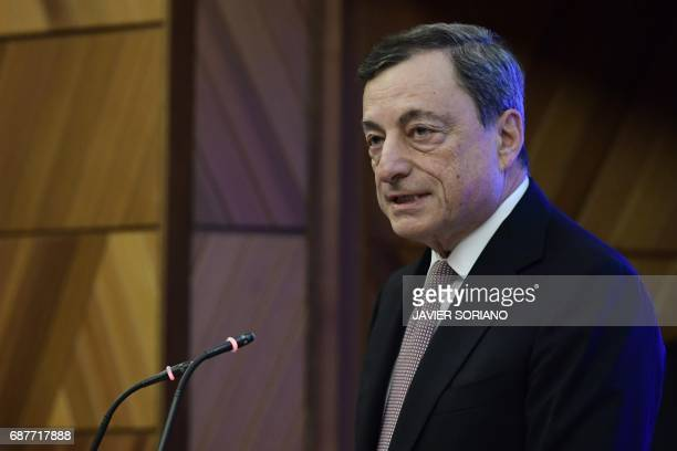 Italian President of the European Central Bank Mario Draghi speaks during a conference in Madrid on May 24 2017 Spanish Chairman of the Spanish...