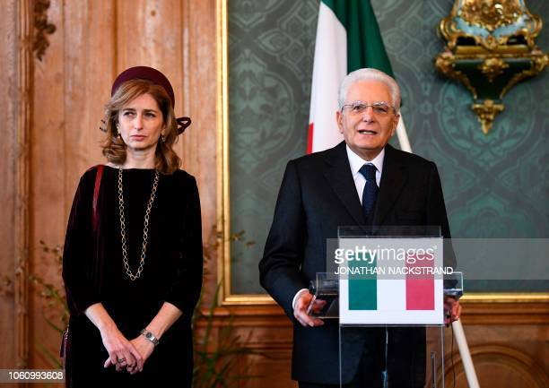 Italian President Sergio Matarella stands next to his daughter Laura Mattarella as he gives a statement together with the Swedish King on November 13...