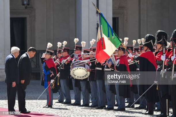 Italian President Sergio Mattarella and Chinese President Xi Jinping review a Honour Guard during a welcoming ceremony upon Xi Jinping's arrival for...