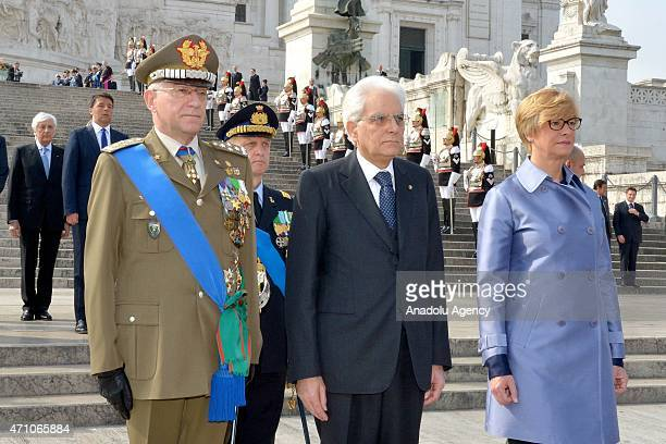 Italian President Sergio Mattarella and Claudio Graziano chief of staff of the Italian Army and Italy's Defence Minister Roberta Pinotti stand in...