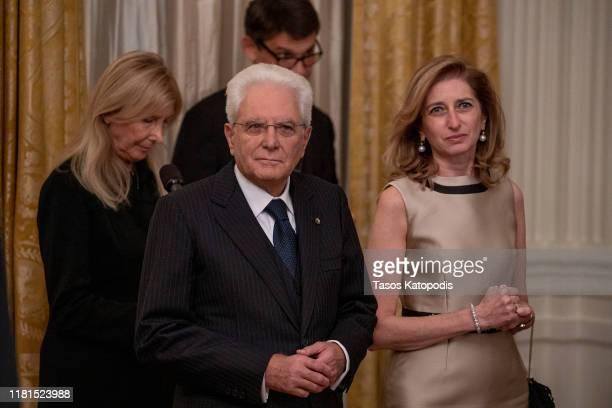 Italian President Sergio Mattarella and his daughter Laura Mattarella stand in the East Room of the White House on October 16 2019 in Washington DC...