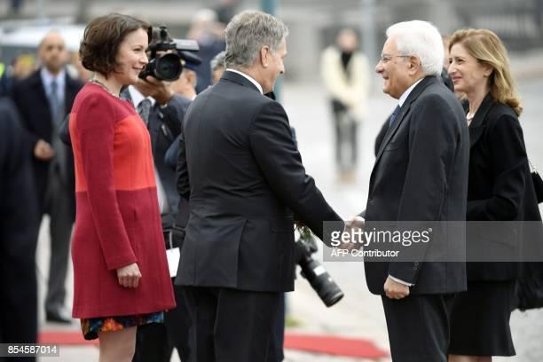 Italian President Sergio Mattarella and his daughter Laura Mattarella are welcomed by Finnish President Sauli Niinistö and his spouse Jenni Haukio in...