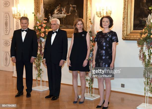 Italian President Sergio Mattarella and his daughter Laura Mattarella pose with Finnish President Sauli Niinisto and his wife Jenni Haukio at the...