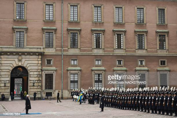 Italian President Sergio Mattarella and King Carl XVI Gustaf of Sweden review an honor guard on November 13 2018 at the Royal Palace in Stockholm at...