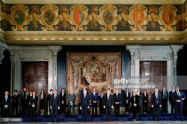 Italian President Sergio Mattarella and Prime Minister Mario Draghi pose for a group photo with Italy's new Cabinet Ministers after the new cabinet...