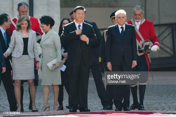 Italian President Sergio Mattarella Chinese President Xi Jinping his wife Peng Liyuan and Mattarella's daughter Laura Mattarella stand at attention...