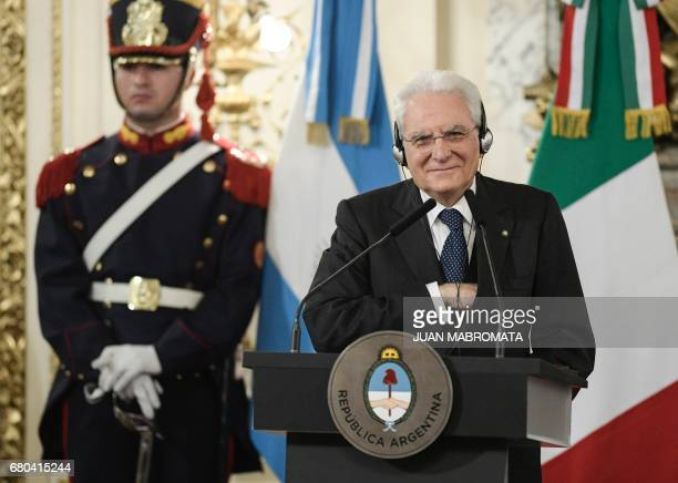 Italian President Sergio Mattarella, gestures as his Argentinian counterpart Mauricio Macri delivers a speech, after a working meeting at the Casa...