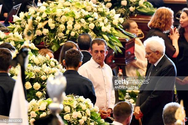 TOPSHOT Italian President Sergio Mattarella pays his respects and meets relatives of the victims of the collapsed Morandi highway bridge upon his...