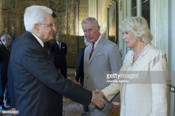 Italian President Sergio Mattarella shakes hands with Camilla Duchess of Cornwall during his meeting with Prince Charles Prince of Wales at the...
